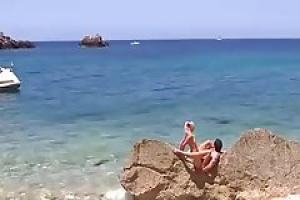 Lustful Mia Magma is gently sucking her friend s rock hard dick on a beautiful beach