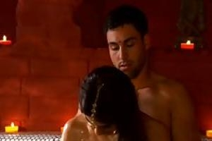 Romantic Indian couple is making love in a bath tub and in front of a fire place