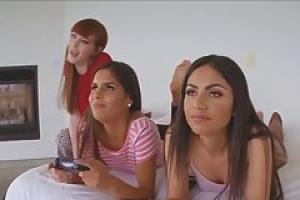 Three babes are playing video games while their friend is trying to fuck all of them